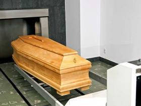 coffin entering the oven of a crematorium
