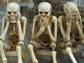 Hear no evil skeletons