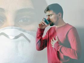 man using asthma inhaler against background of mask - signifying coronavirus