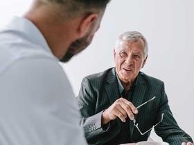 Talking to an elderly doctor