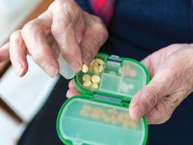 older person with pills