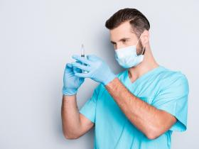 Anaesthetist with injection