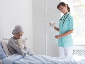 child with cancer in hospital with nurse