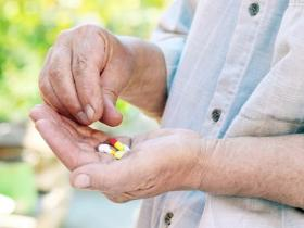 Woman aged over 65 holding pills