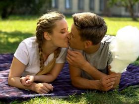 Teenagers kissing