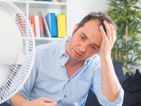Stressed hot sweaty man