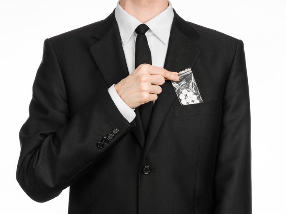 Drug addict in suit