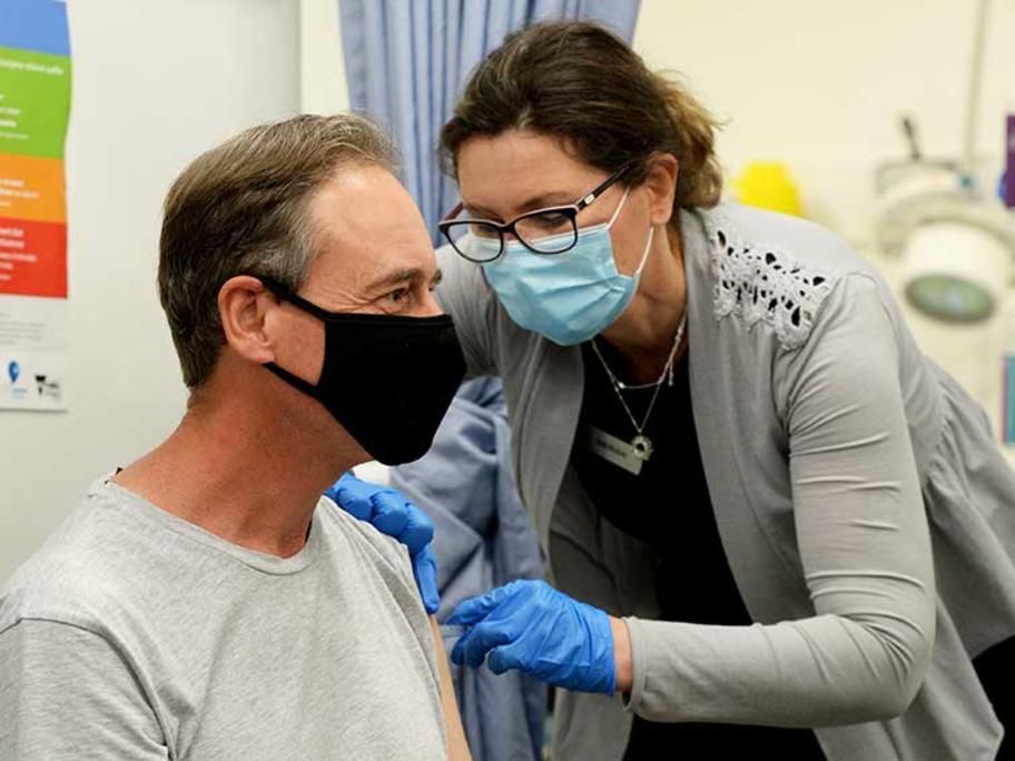 Greg Hunt receives his vaccine