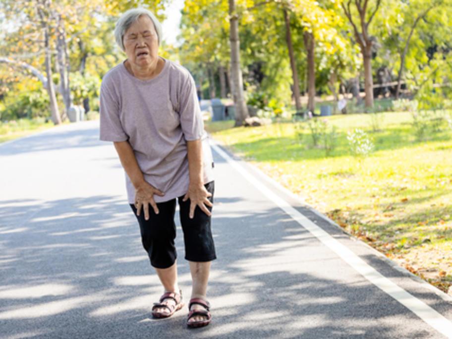 Breathless senior Asian woman