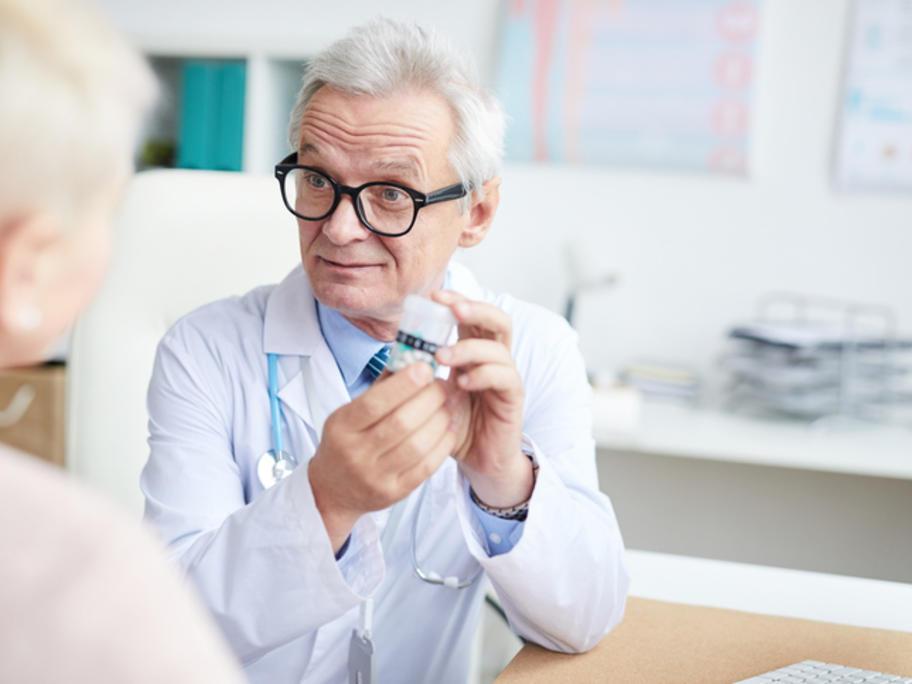 Hospital doctor prescribing pills