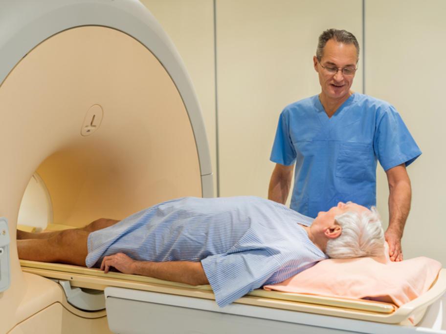 Senior man having MRI scan