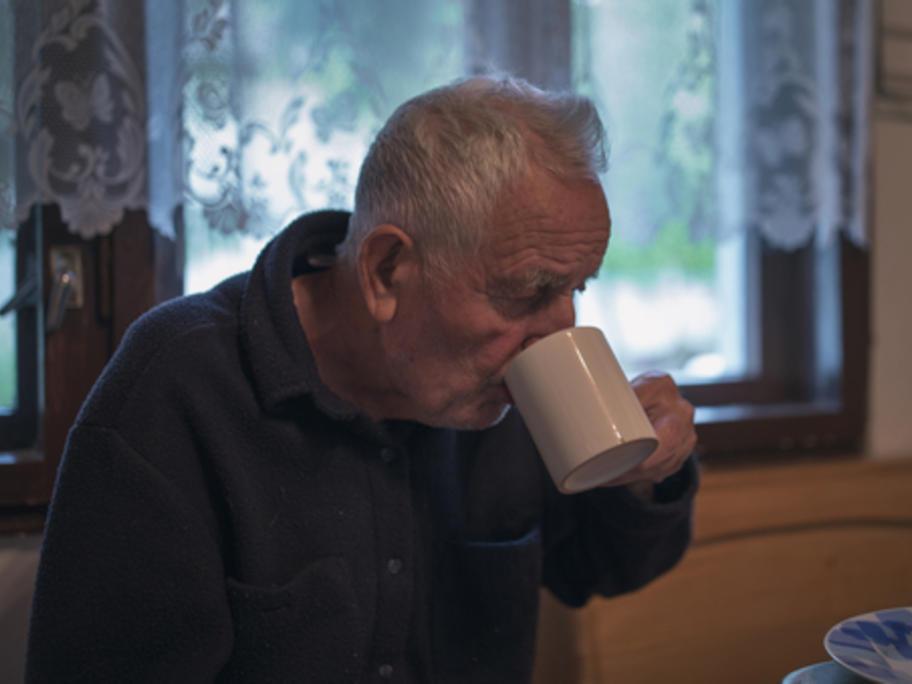 senior man drinking tea at home