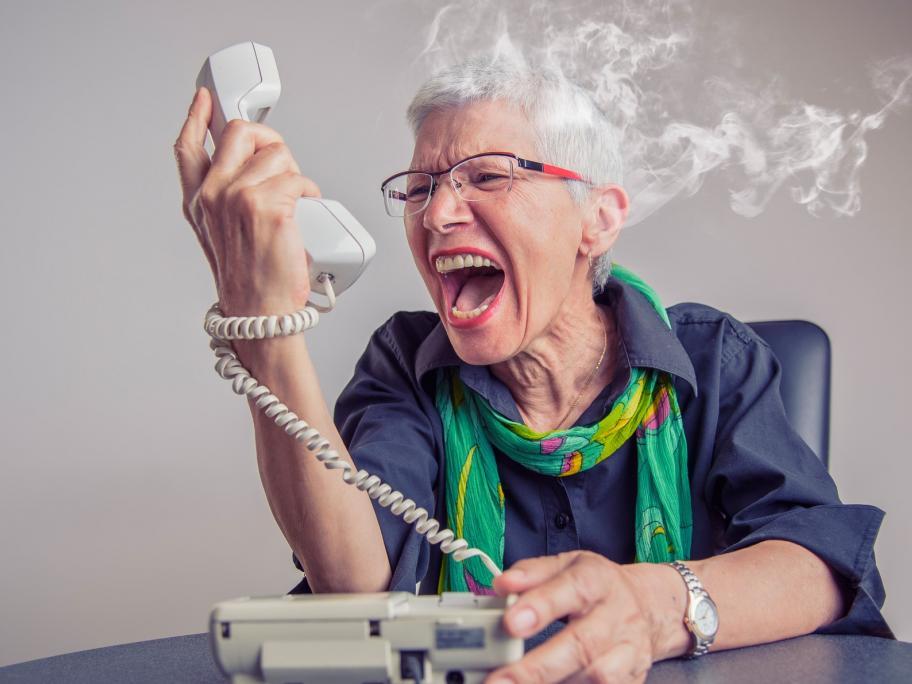 Senior screaming at phone