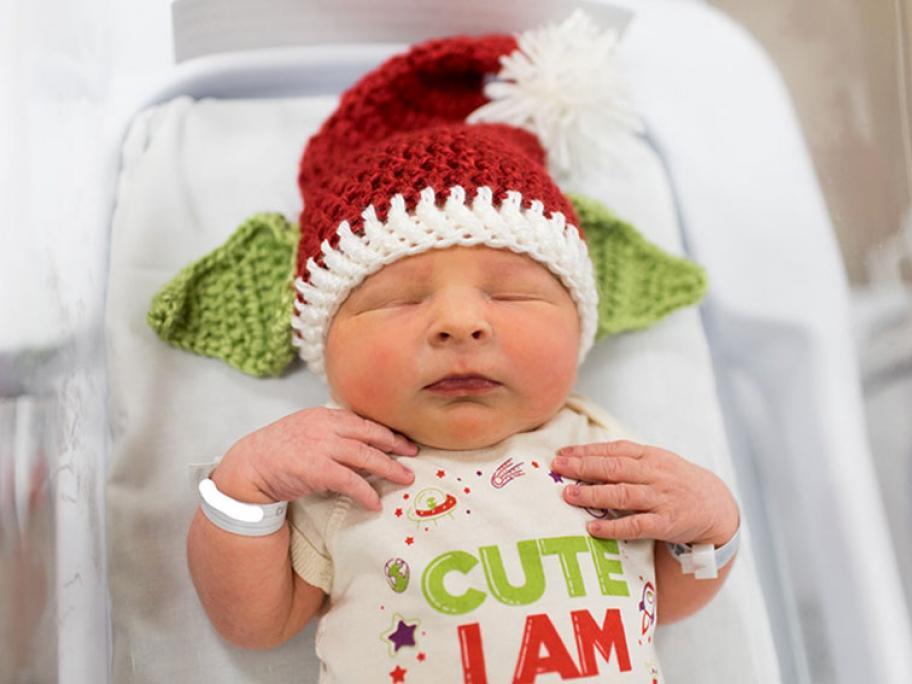Baby in Santa hat with Yoda ears
