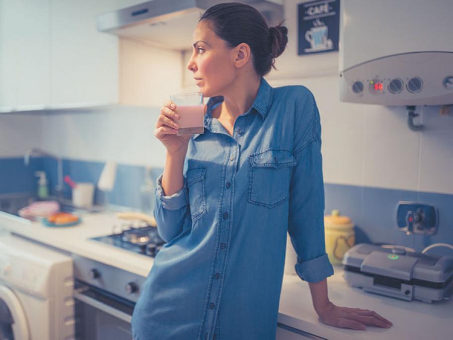 woman drinking milk supplement sustagen