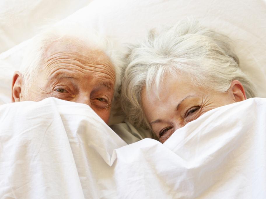 Seniors in bed