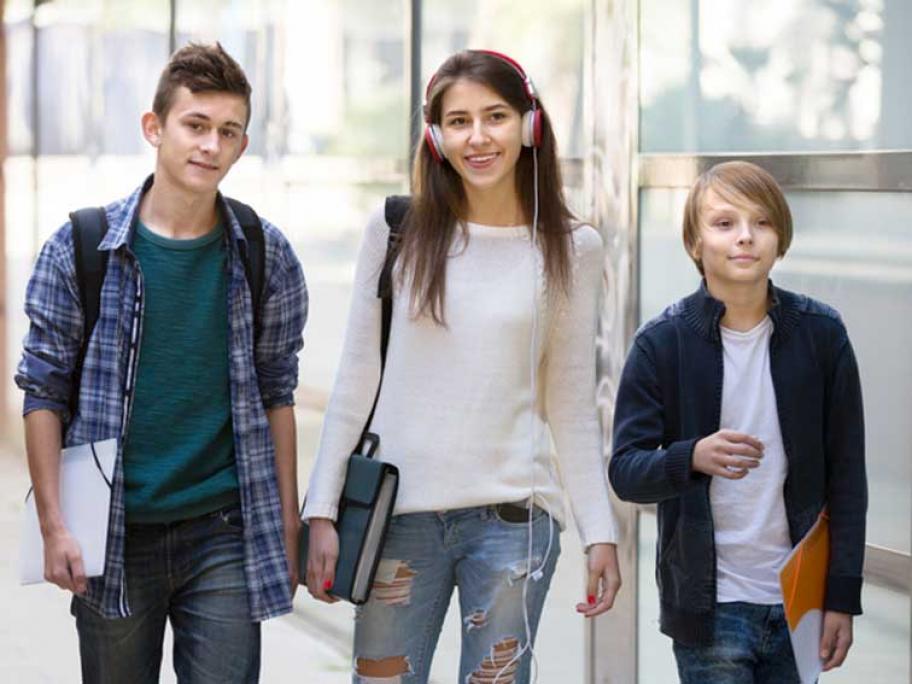 Three teens walking