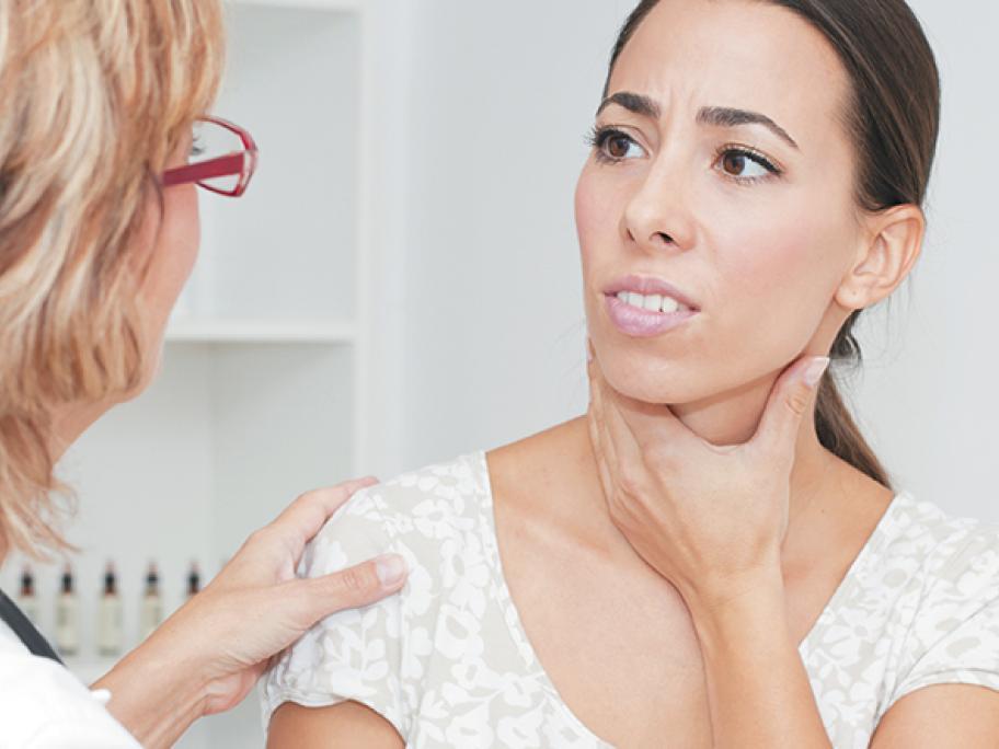 woman sore throat neck