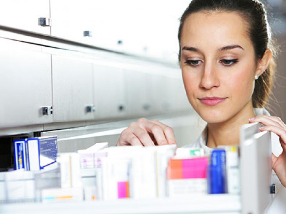 pharmacist choosing medicine