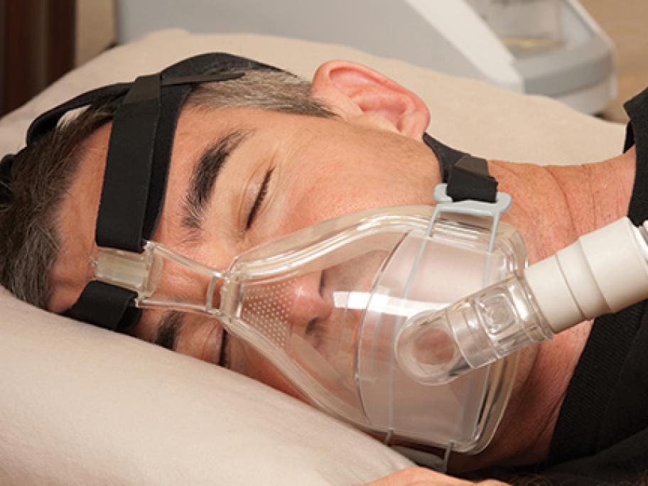 Man wearing CPAP orofacial mask