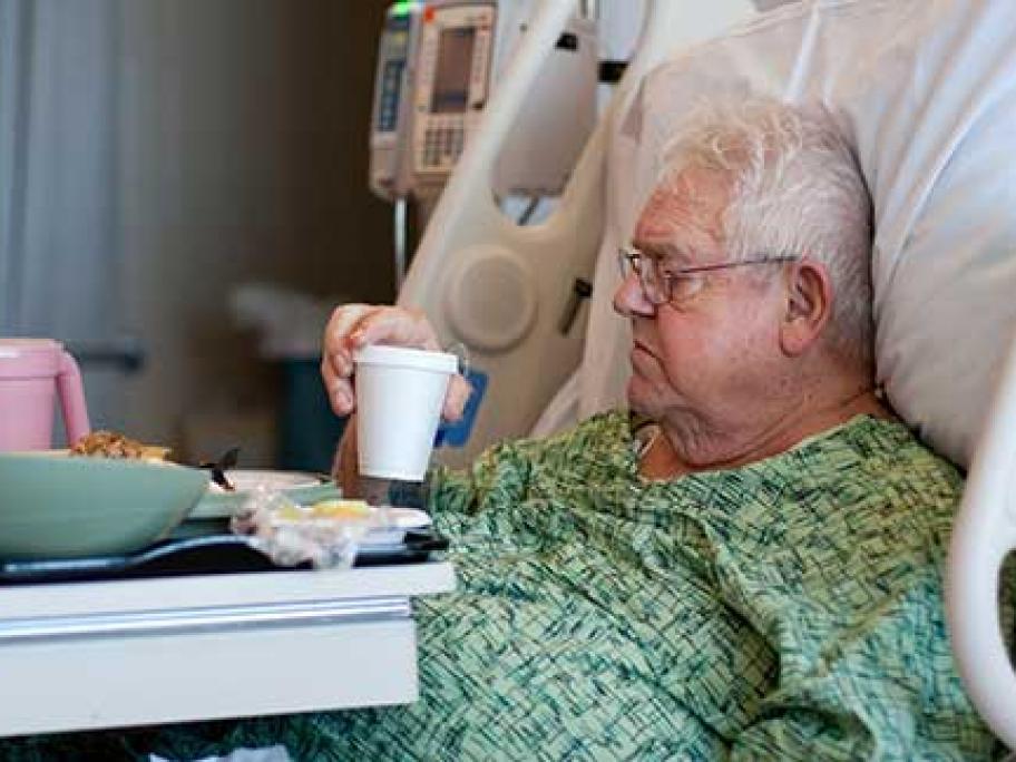 older patient in hospital bed