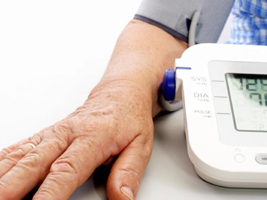 Old man having blood pressure measured